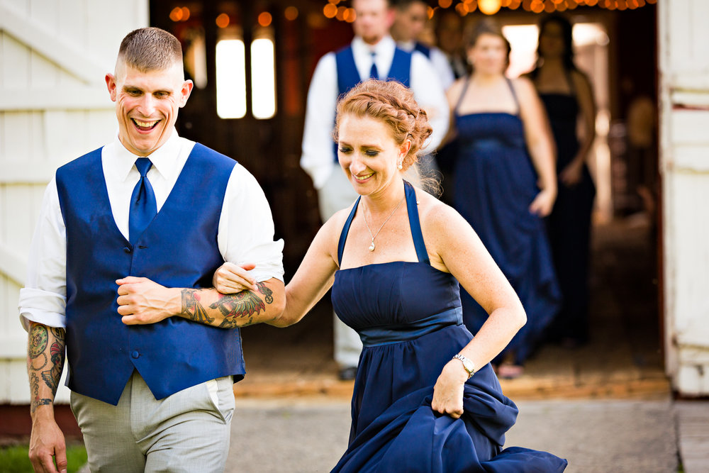 bozeman-montana-wedding-roys-barn-bridesmaid-groomsmen-skip-to-reception.jpg