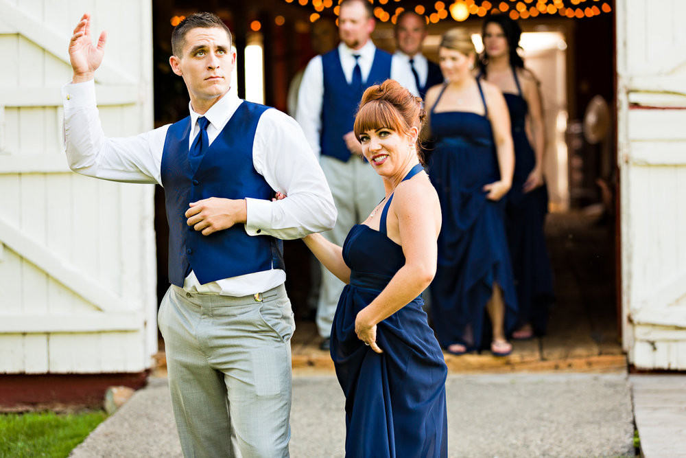 bozeman-montana-wedding-roys-barn-bridesmaid-groomsmen-strike-pose.jpg