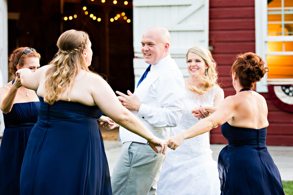 bozeman-montana-wedding-roys-barn-bridesmaids-dance-around-groom.jpg
