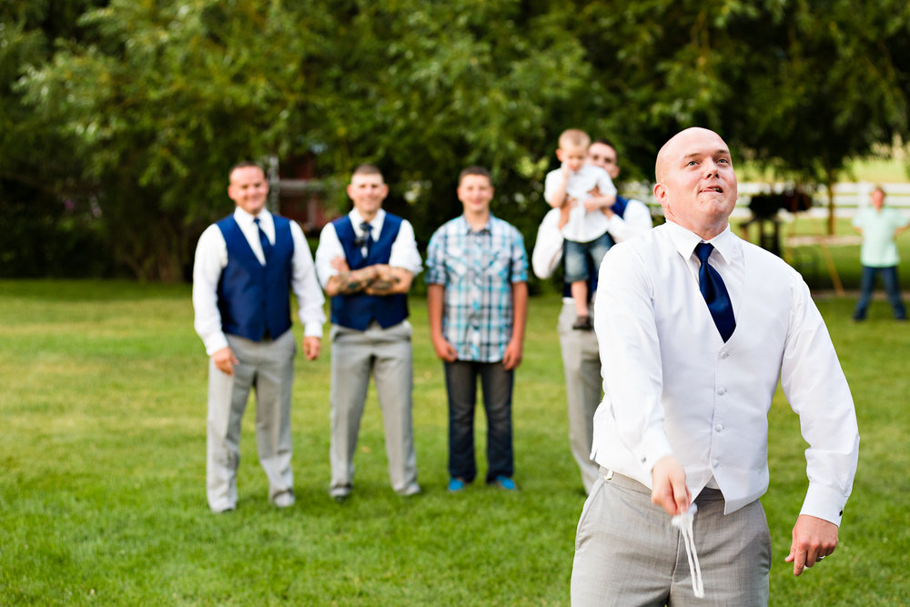 bozeman-montana-wedding-roys-barn-groom-tosses-garter.jpg