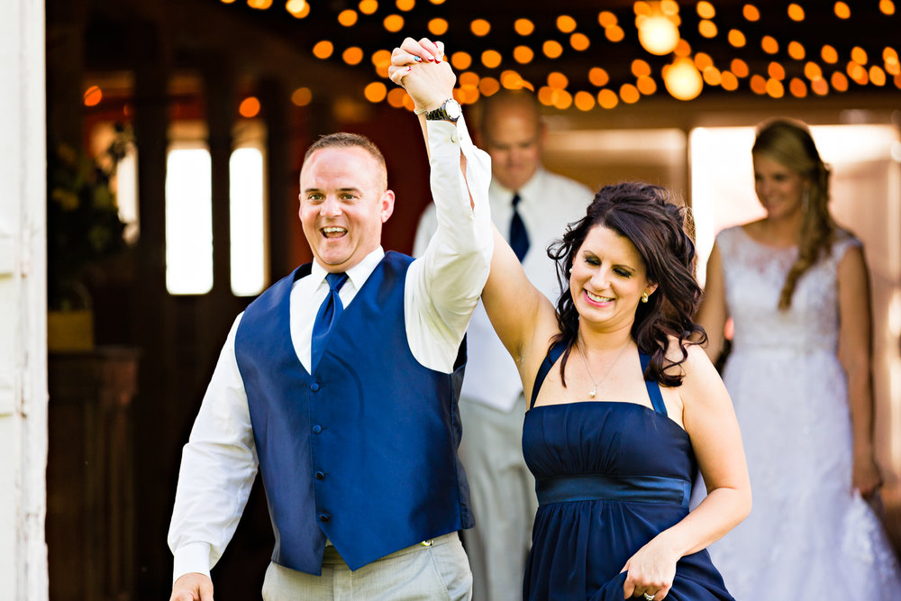 bozeman-montana-wedding-roys-barn-maid-honor-and-best-man-enter-reception.jpg