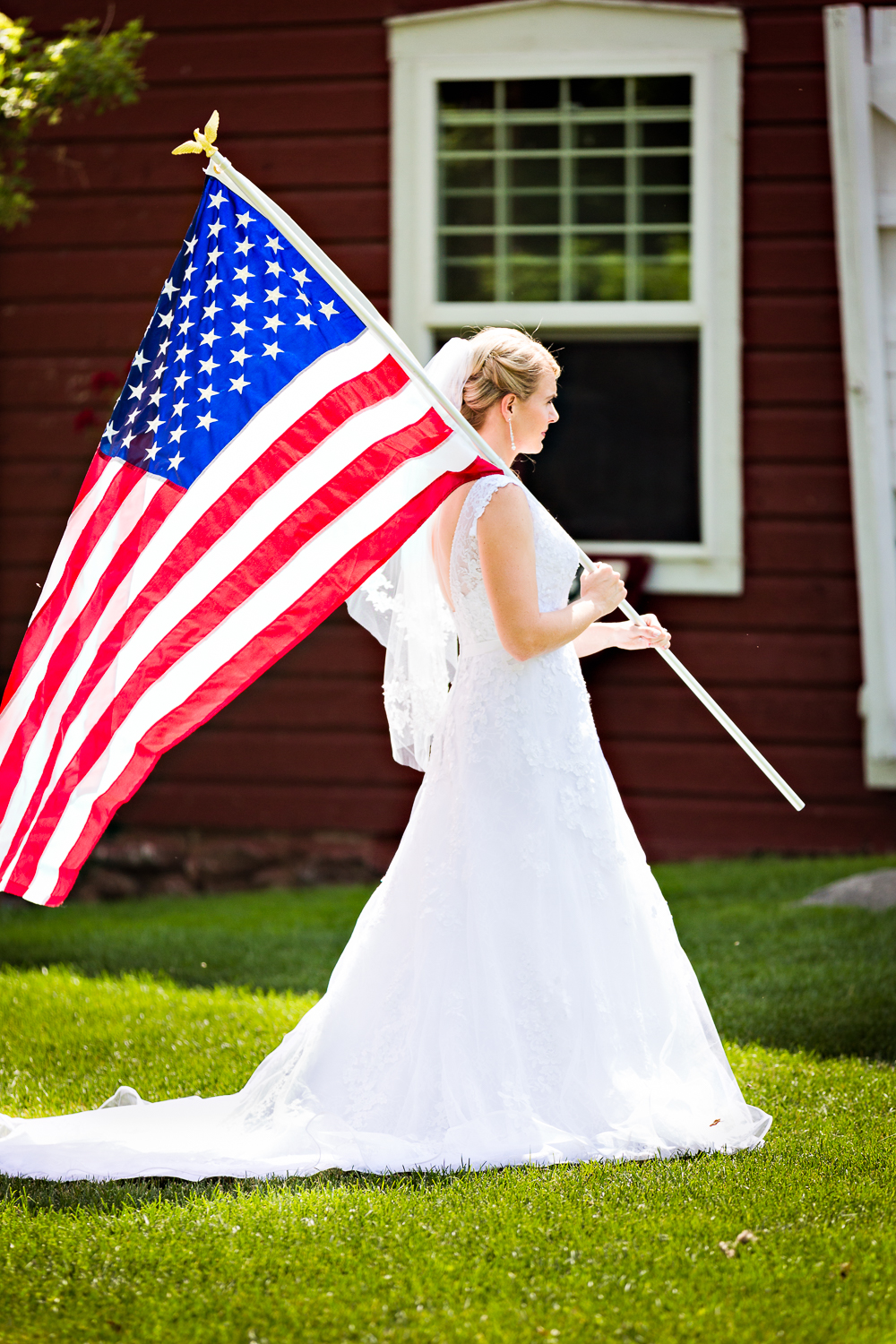 bozeman-montana-wedding-roys-barn-bride-carrying-american-flag.jpg