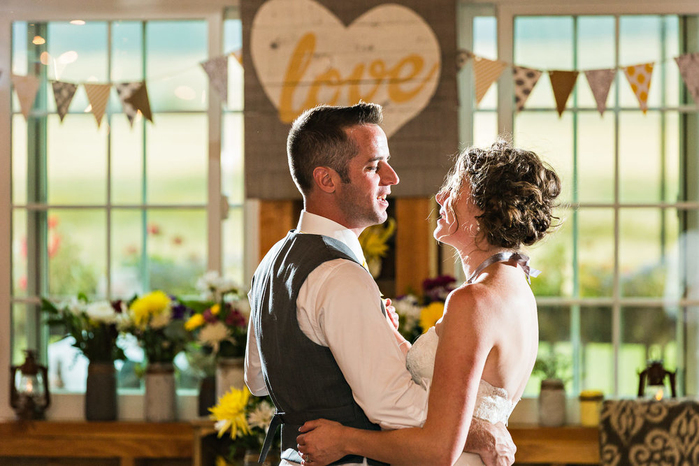 bozeman-wedding-big-yellow-barn-bride-groom-first-dance.jpg
