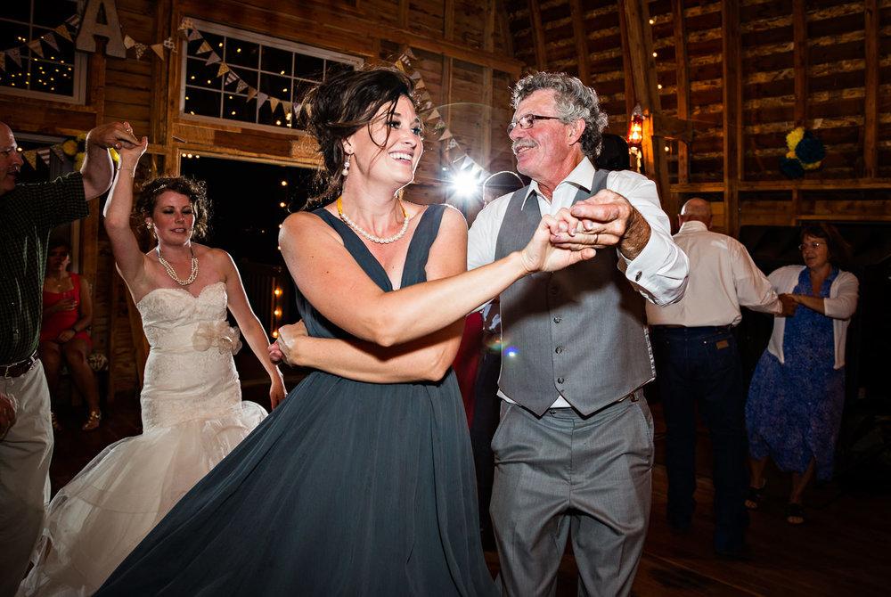 bozeman-wedding-big-yellow-barn-reception-candid-father-daughter-dancing.jpg
