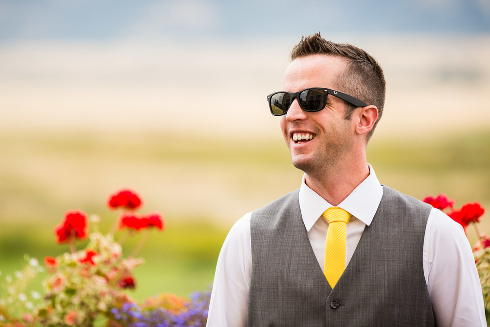 bozeman-big-yellow-barn-groom-laughs.jpg