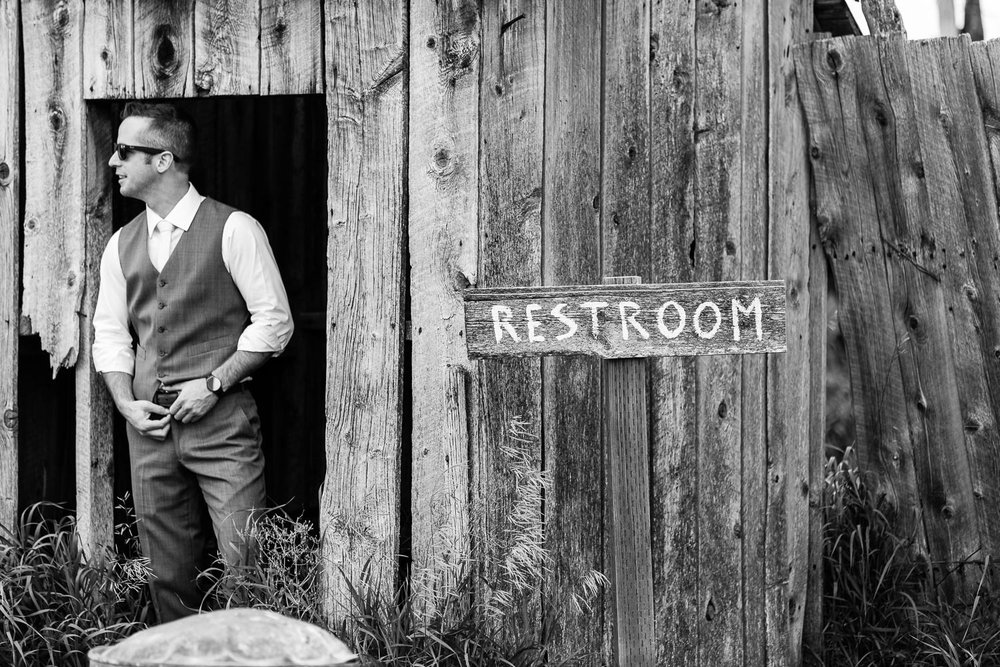 bozeman-wedding-big-yellow-barn-groom-restroom.jpg