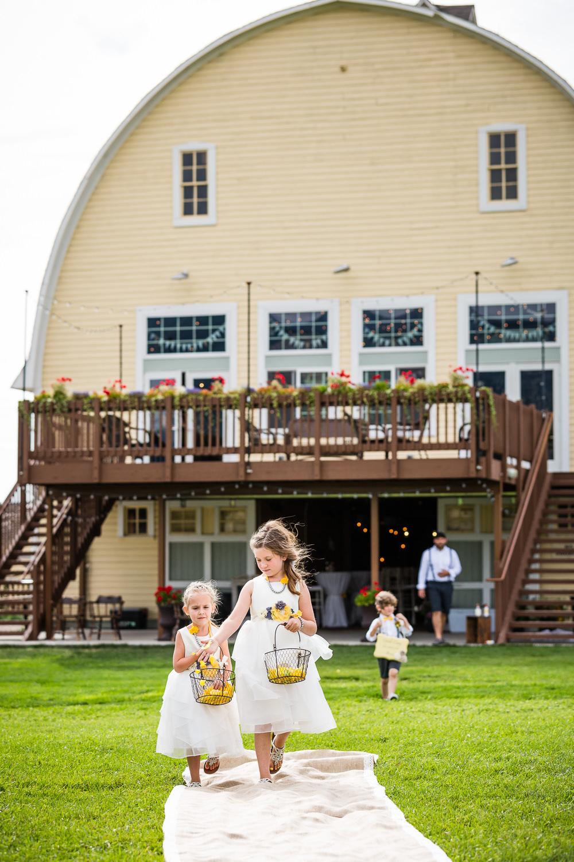 bozeman-wedding-big-yellow-barn-ceremony-flowergirls.jpg