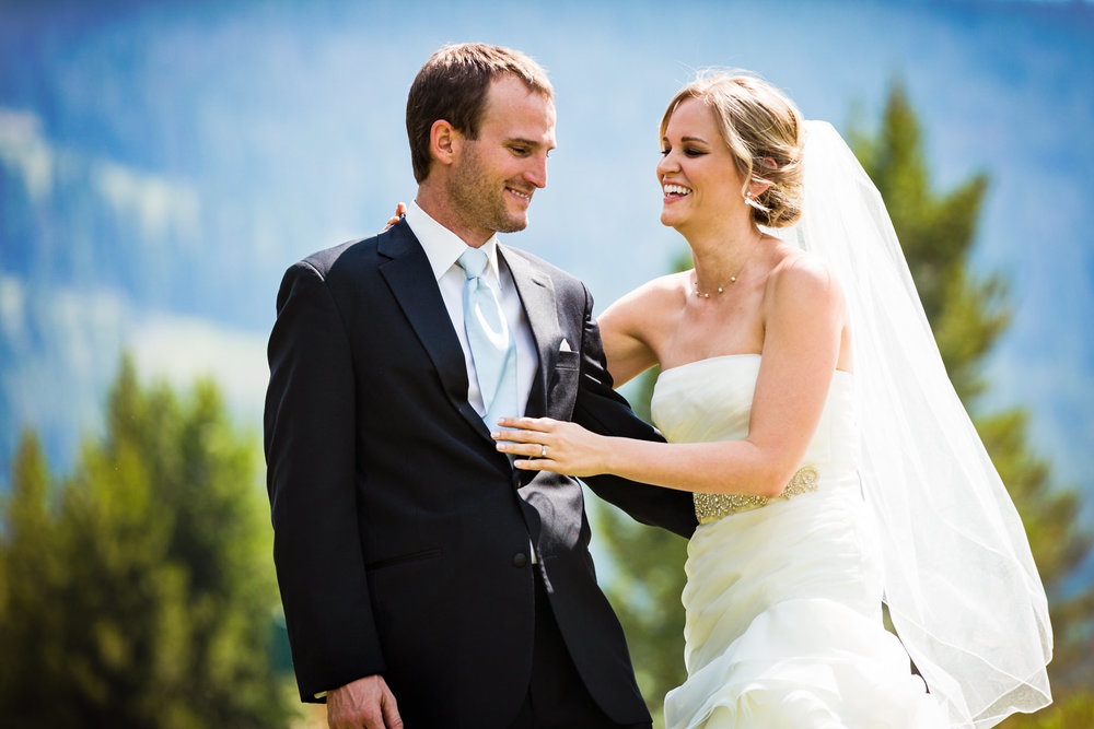 big-sky-resort-wedding-bride-hugs-groom.jpg