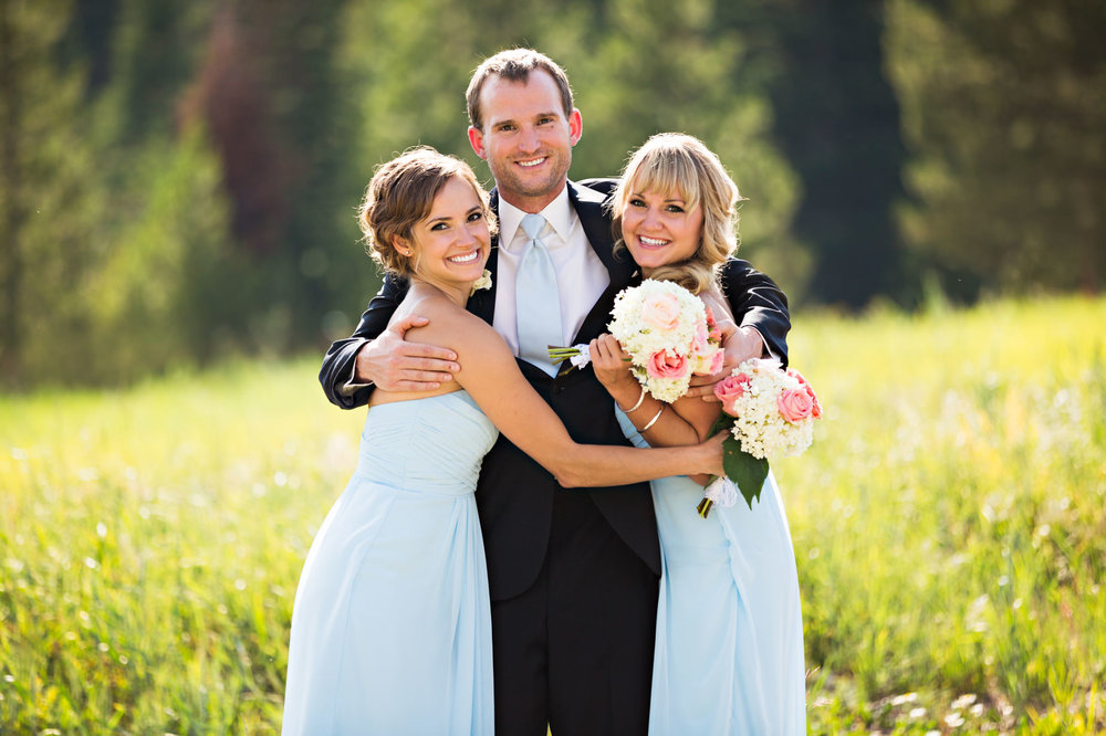 big-sky-resort-wedding-groom-hugs-sisters.jpg