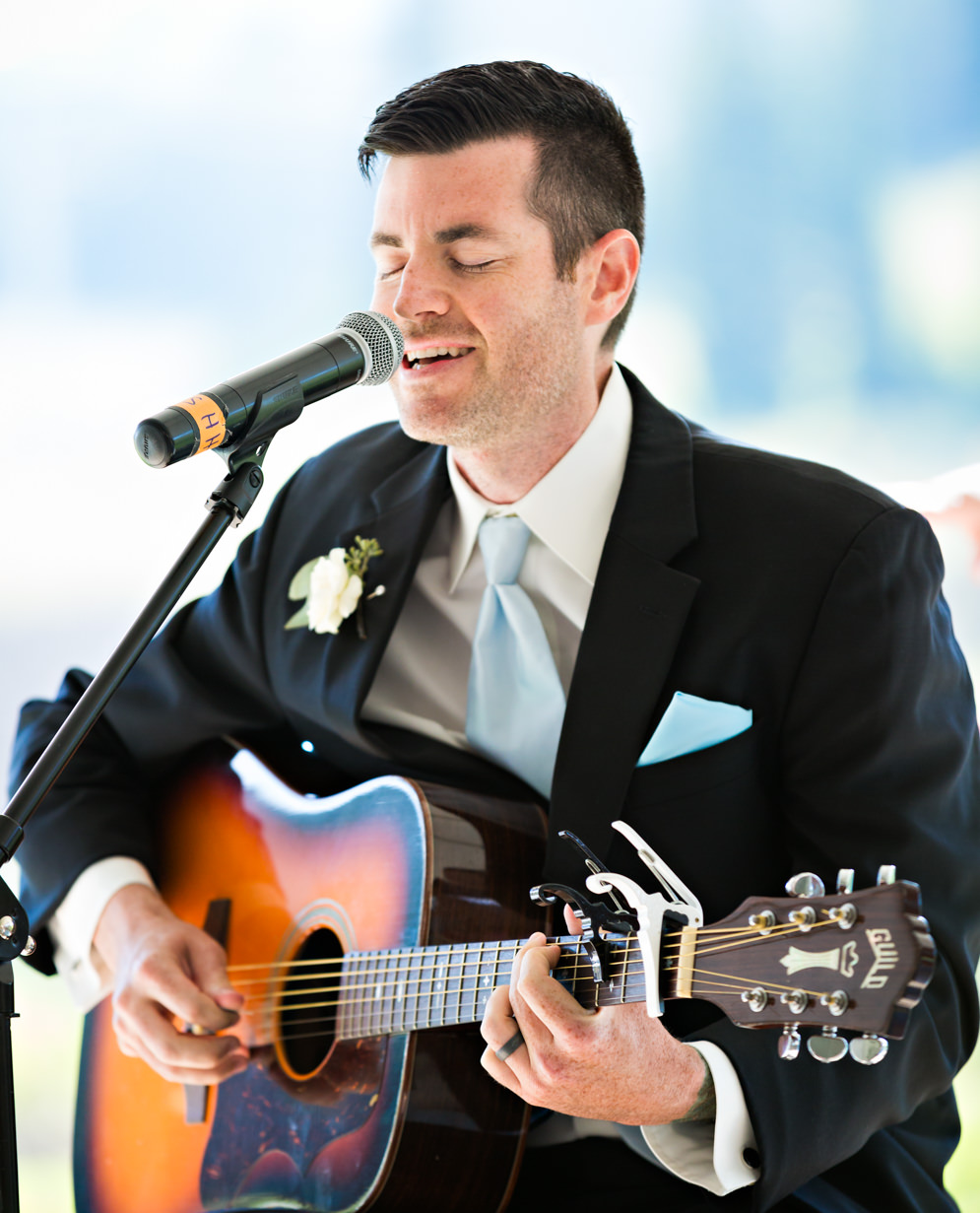 big-sky-resort-wedding-brother-sings-during-ceremony.jpg