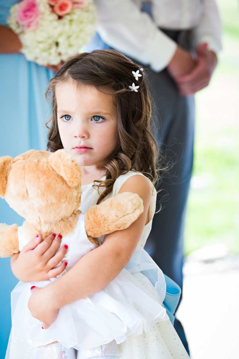 big-sky-resort-wedding-flowergirl-hugs-bear.jpg