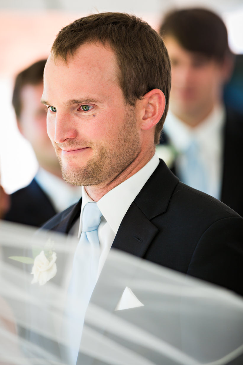 big-sky-resort-wedding-groom-looks-at-bride-during-ceremony.jpg