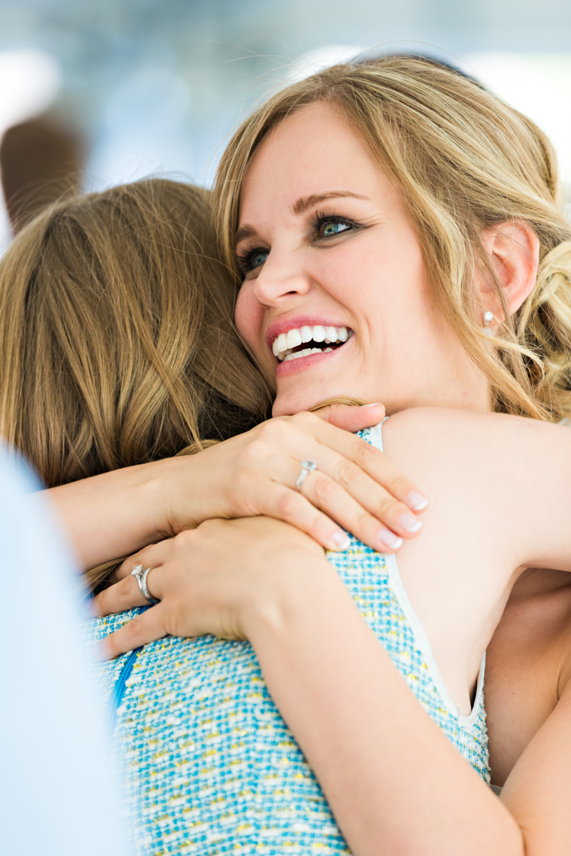 big-sky-resort-wedding-bride-hugs-guest.jpg