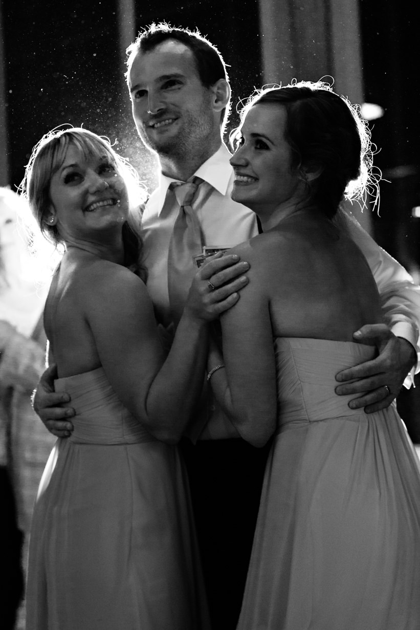 big-sky-resort-wedding-groom-dances-with-sisters.jpg