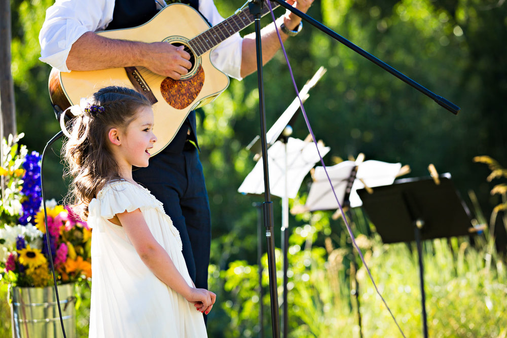 mcleod-montana-wedding-flowergirl-singing.jpg