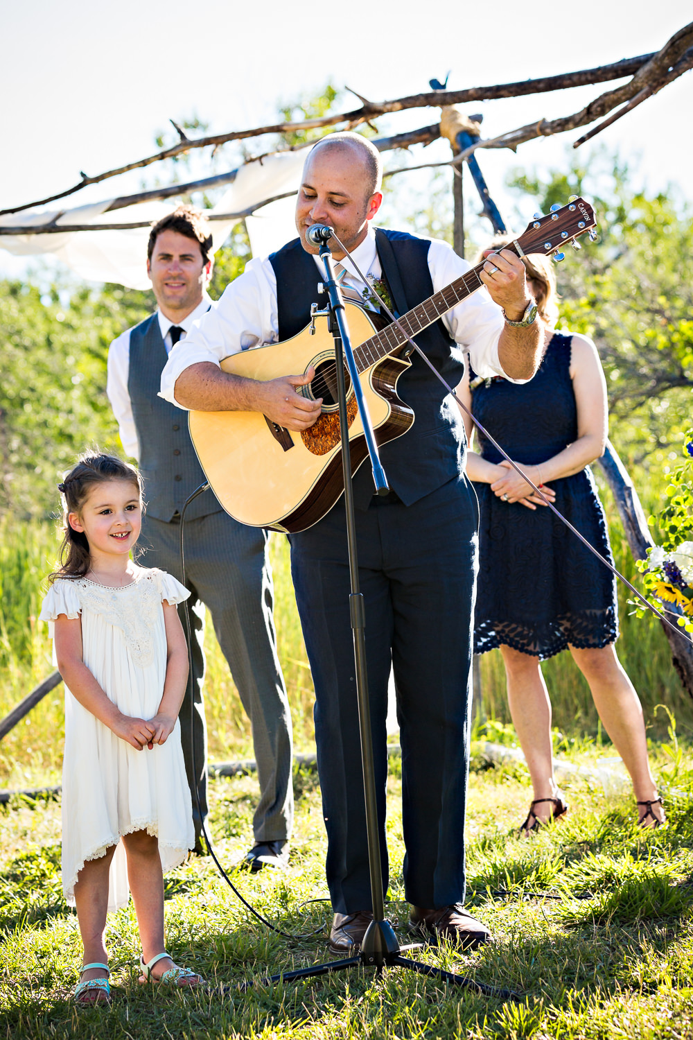 mcleod-montana-wedding-flowergirl-sings-dad-plays-guitar.jpg