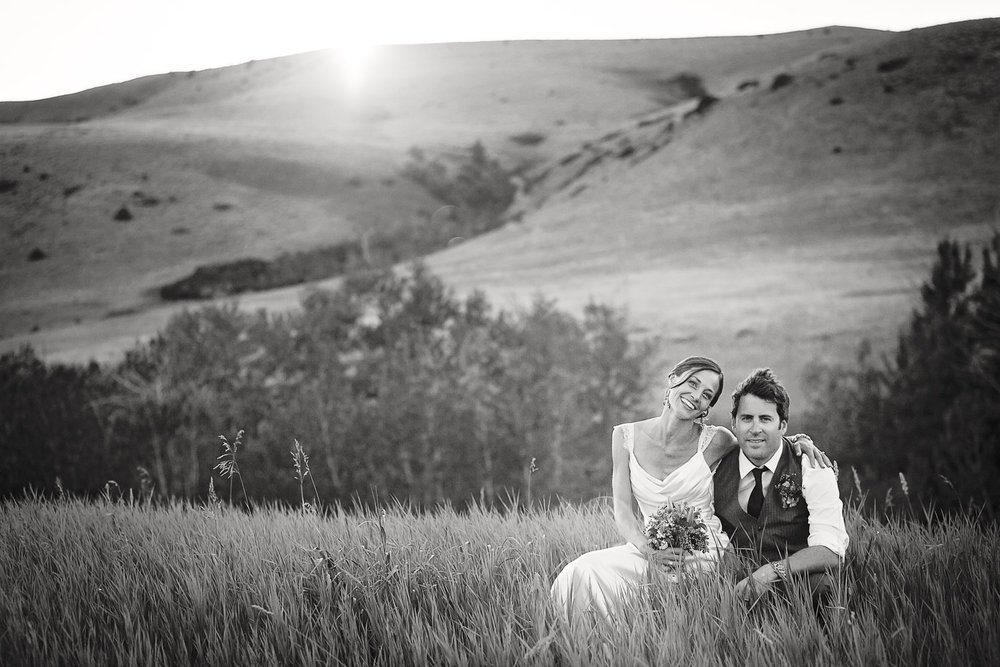 mcleod-montana-wedding-couple-sitting-grass-at-sunset.jpg