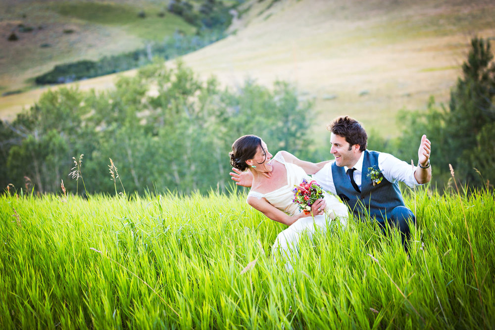 mcleod-montana-wedding-couple-sitting-tall-grass.jpg