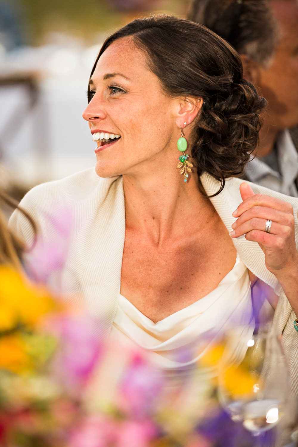 mcleod-montana-wedding-bride-laughs-during-toasts.jpg