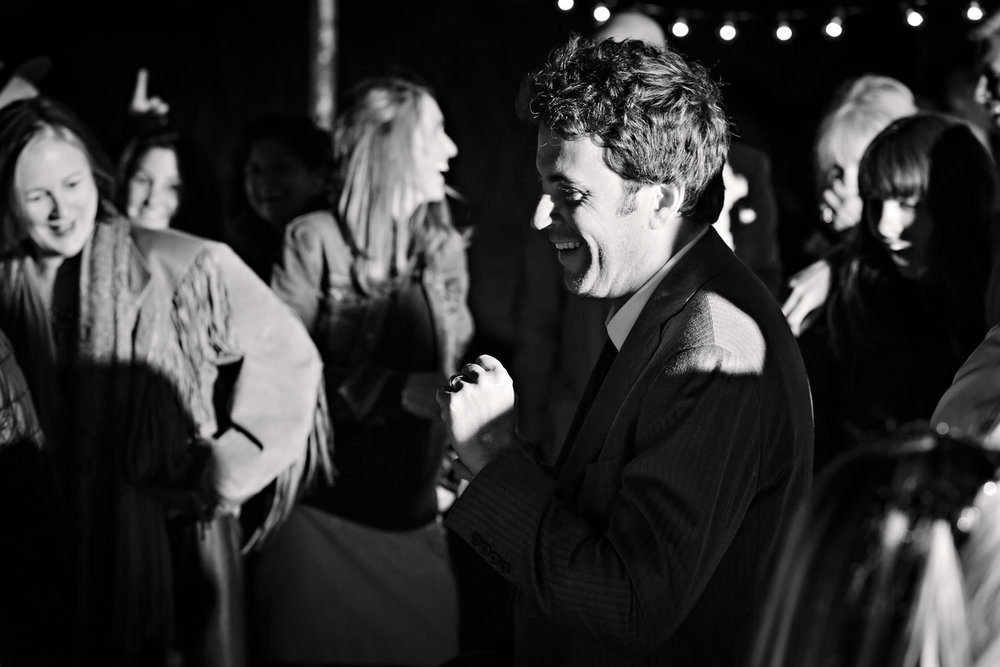 mcleod-montana-wedding-groom-laughs-dances.jpg