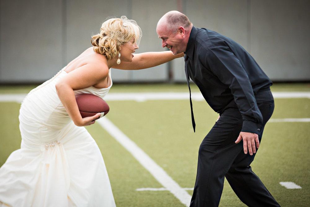 missoula-museum-mountain-flying-wedding-bride-groom-play-football.jpg