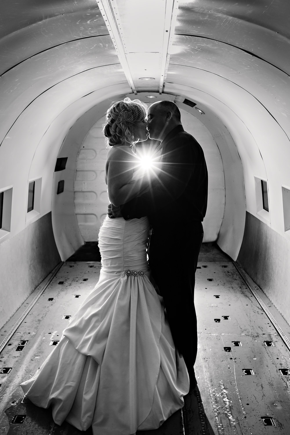 missoula-museum-mountain-flying-wedding-couple-kissing-inside-airplane.jpg