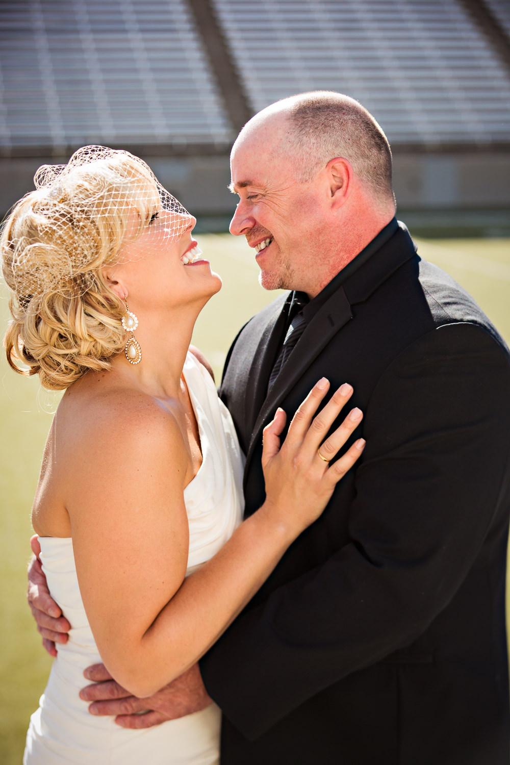 missoula-museum-mountain-flying-wedding-couple-laughing-football-field.jpg