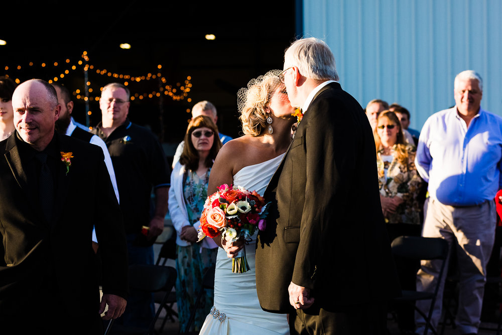 missoula-museum-mountain-flying-wedding-bride-kisses-father-during-ceremony.jpg