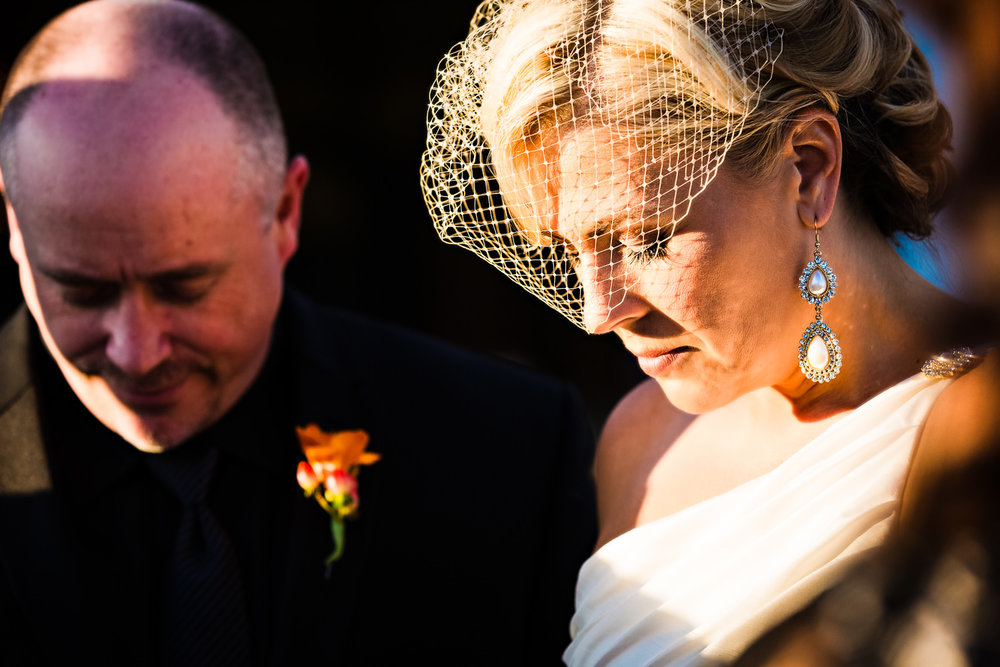 missoula-museum-mountain-flying-wedding-bride-prays-during-ceremony.jpg