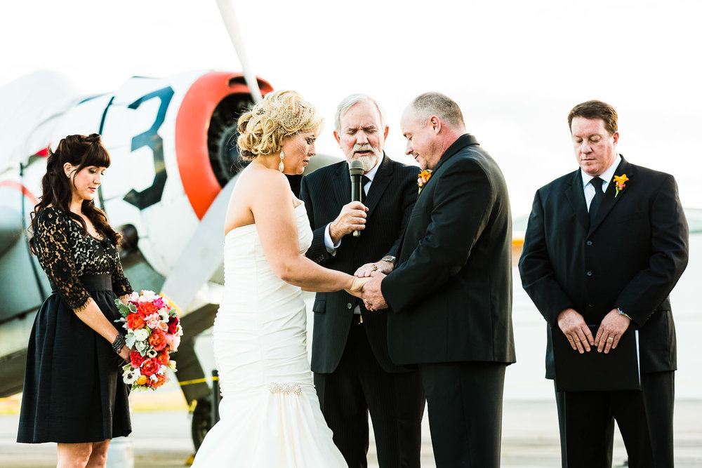 missoula-museum-mountain-flying-wedding-couple-prays-during-ceremony.jpg