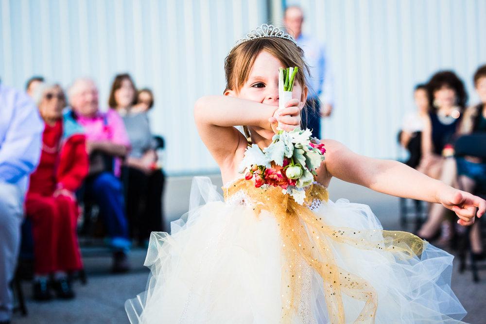 missoula-museum-mountain-flying-wedding-flowergirl-walks-ais;e.jpg