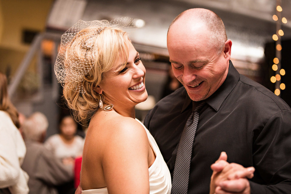 missoula-museum-mountain-flying-bride-laughs-dances-with-husband.jpg