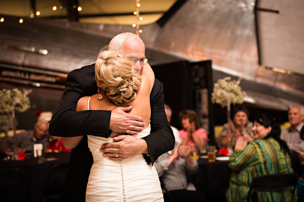 missoula-museum-mountain-flying-father-hugs-daughter-first-dance.jpg