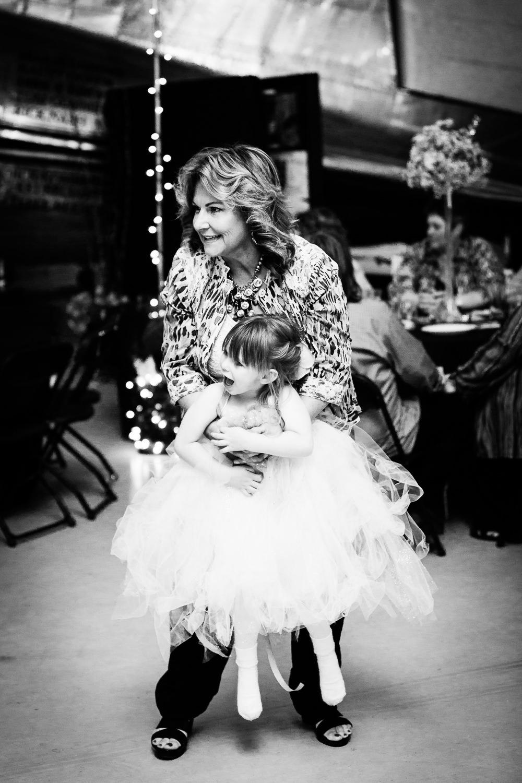 missoula-museum-mountain-flying-wedding-flowergirl-dancing.jpg