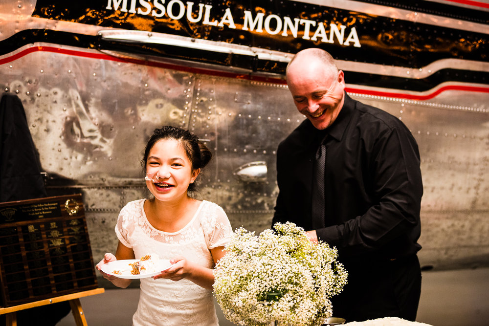 missoula-museum-mountain-flying-wedding-groom-smears-girl-with-cake.jpg