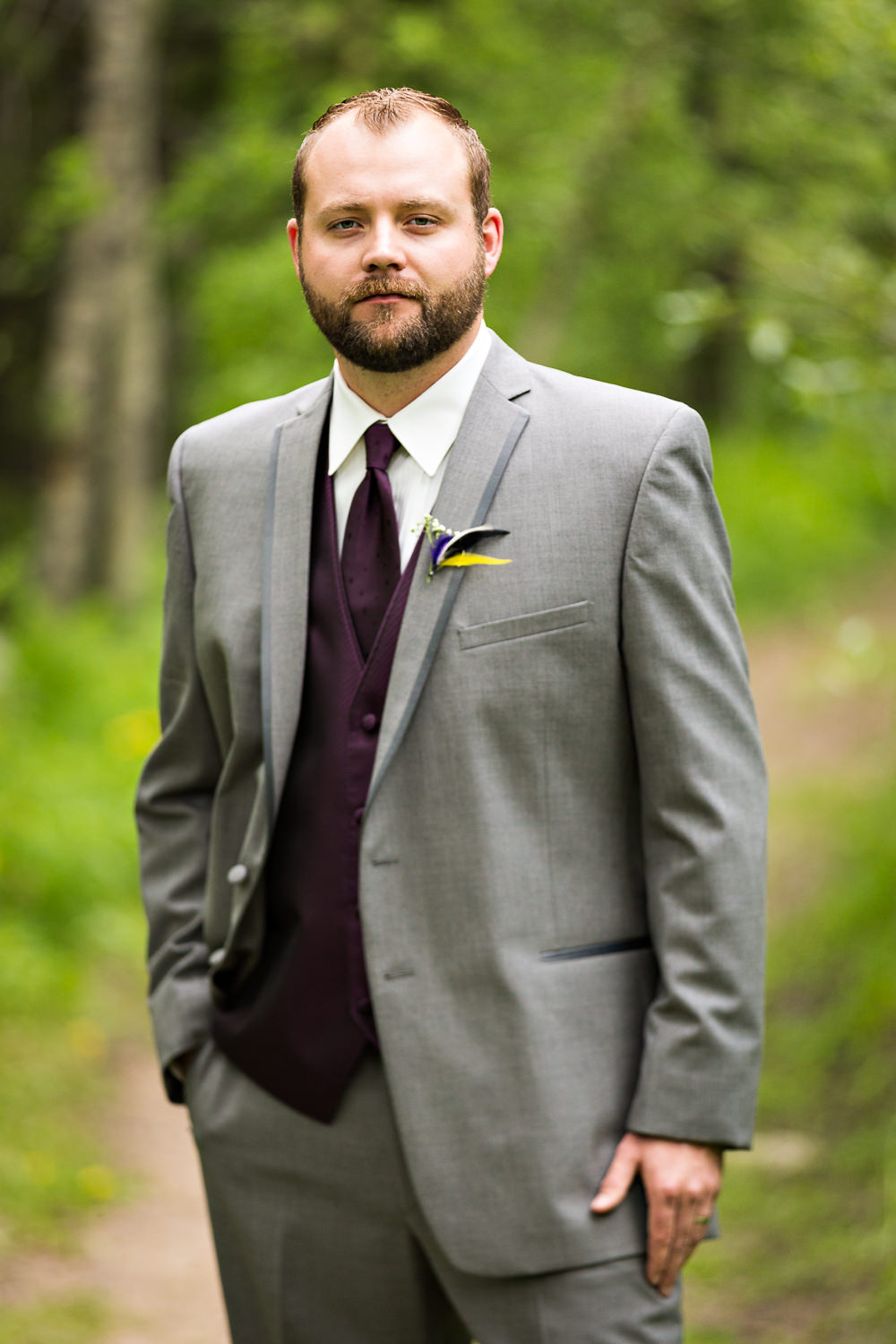 rock-creek-resort-red-lodge-groom-serious-in-forest.jpg