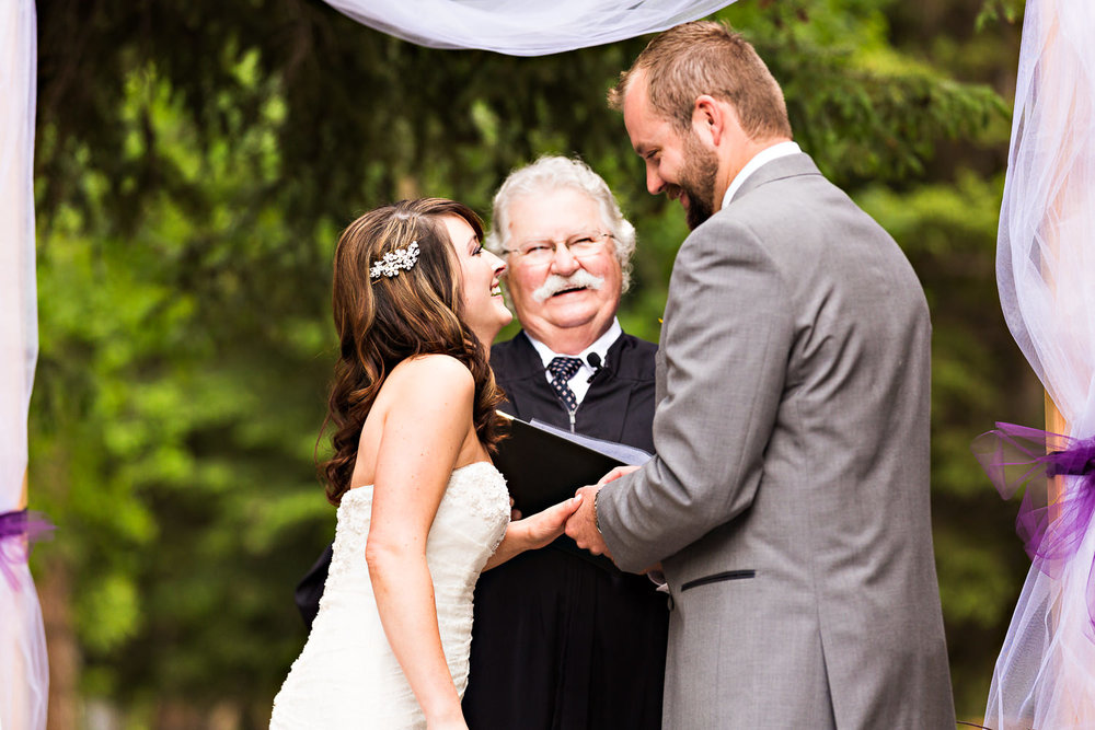 rock-creek-resort-red-lodge-laughing-while-exchanging-rings.jpg