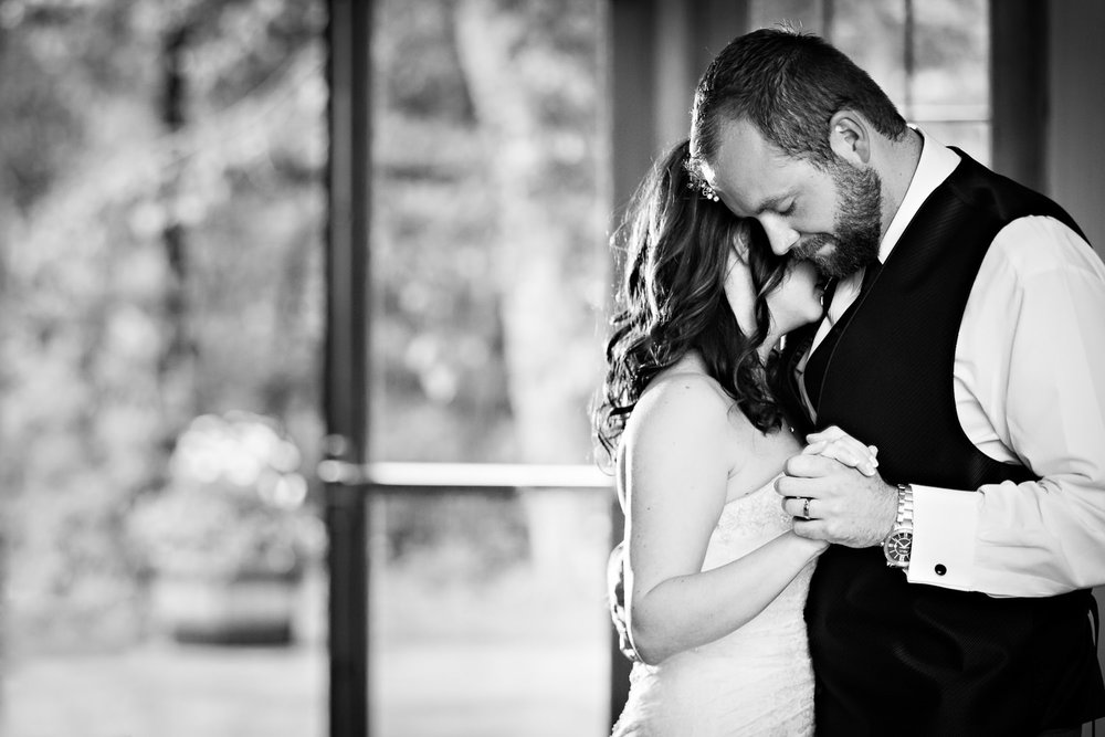 rock-creek-resort-red-lodge-first-dance-groom-hugs-bride.jpg