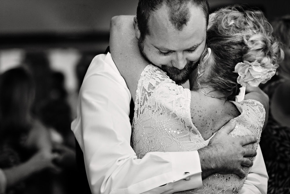 rock-creek-resort-red-lodge-first-dance-groom-hugs-mom.jpg