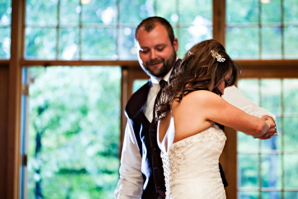rock-creek-resort-red-lodge-reception-first-dance-bride-twirls.jpg