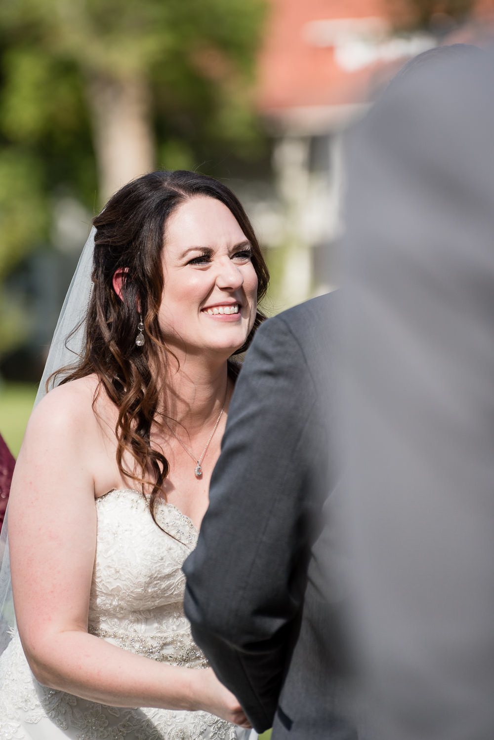 heritage-hall-missoula-montana-bride-laughing-during-ceremony.jpg