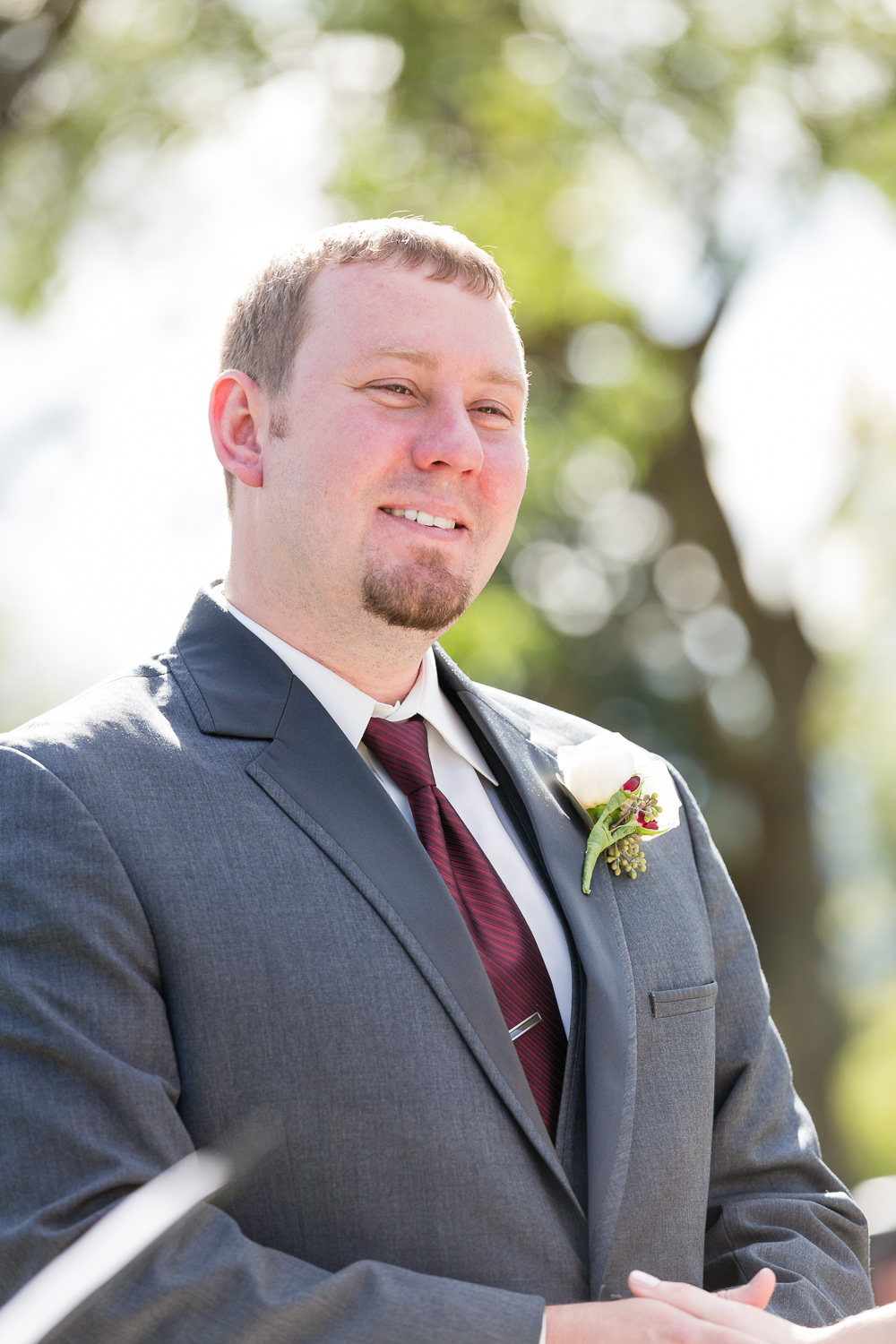 heritage-hall-missoula-montana-groom-laughs-during-ceremony.jpg