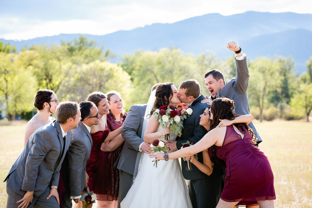 heritage-hall-missoula-montana-wedding-party-cheers-during-kiss.jpg