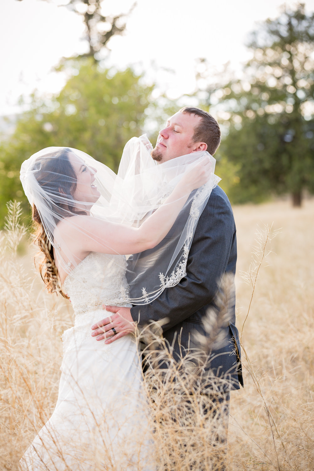 heritage-hall-missoula-montana-bride-gives-groom-veil-beard.jpg
