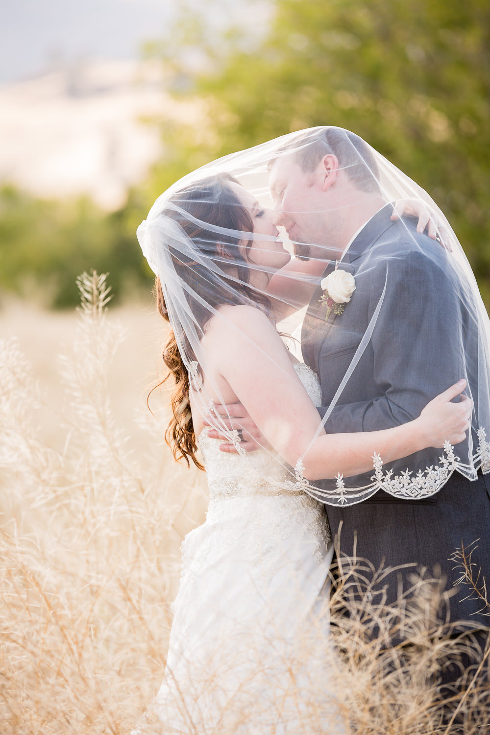 heritage-hall-missoula-montana-bride-groom-kiss-under-veil.jpg