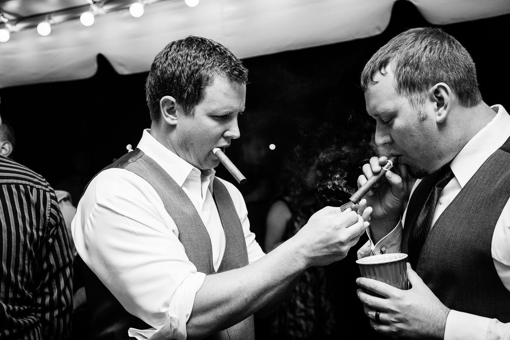 heritage-hall-missoula-montana-best-man-lights-grooms-cigar.jpg