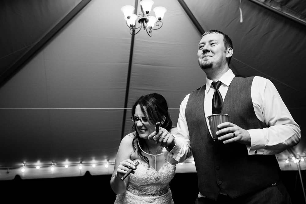 heritage-hall-missoula-montana-bride-laughs-groom-smokes-cigar.jpg