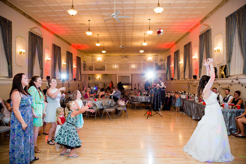 heritage-hall-missoula-montana-bride-tosses-bouquet.jpg