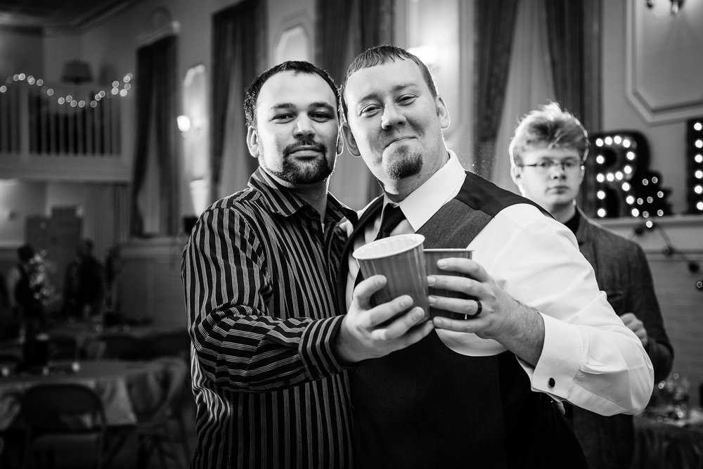 heritage-hall-missoula-montana-groom-friend-share-reception-beers.jpg