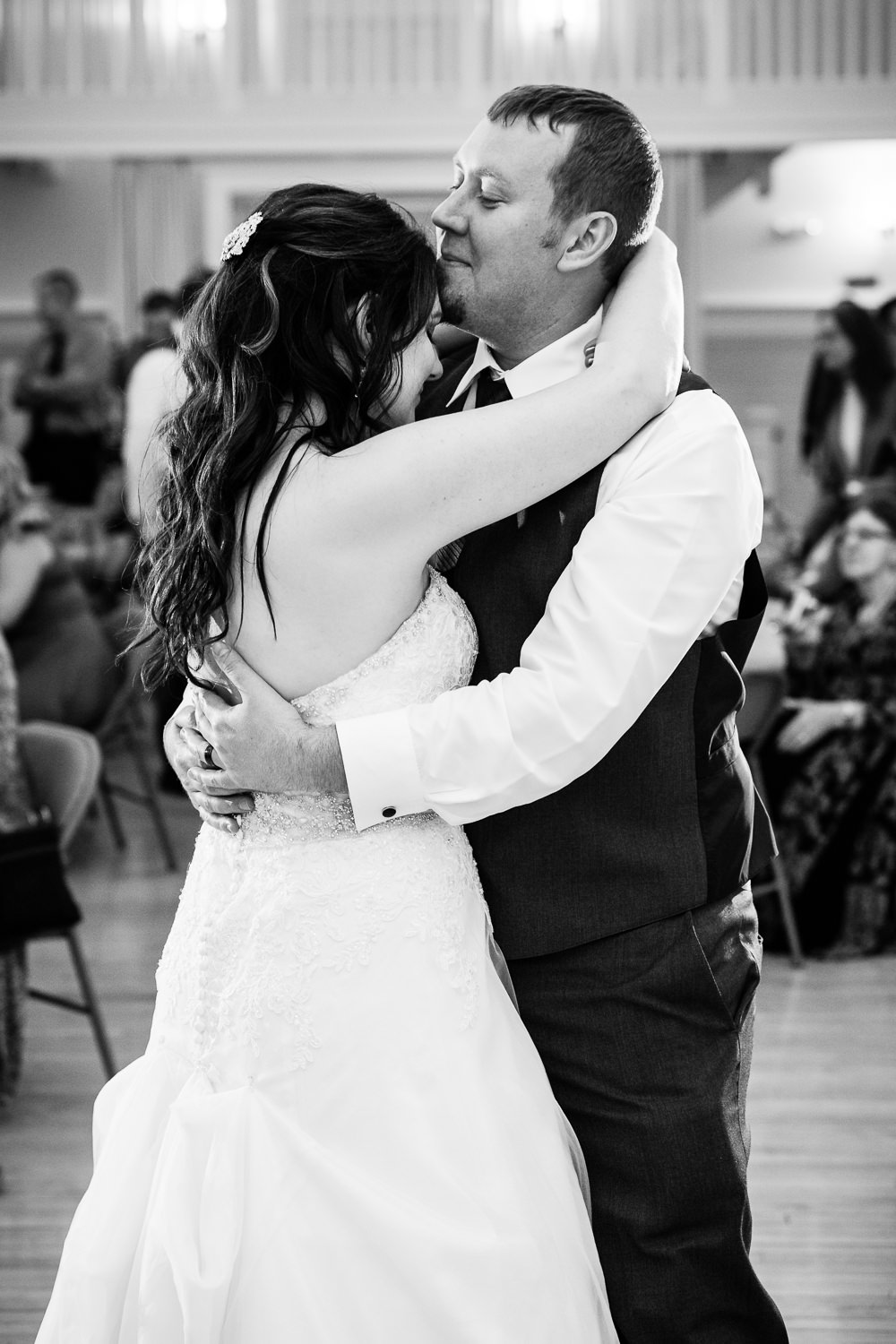 heritage-hall-missoula-montana-groom-kisses-brides-forehead-during-first-dance.jpg
